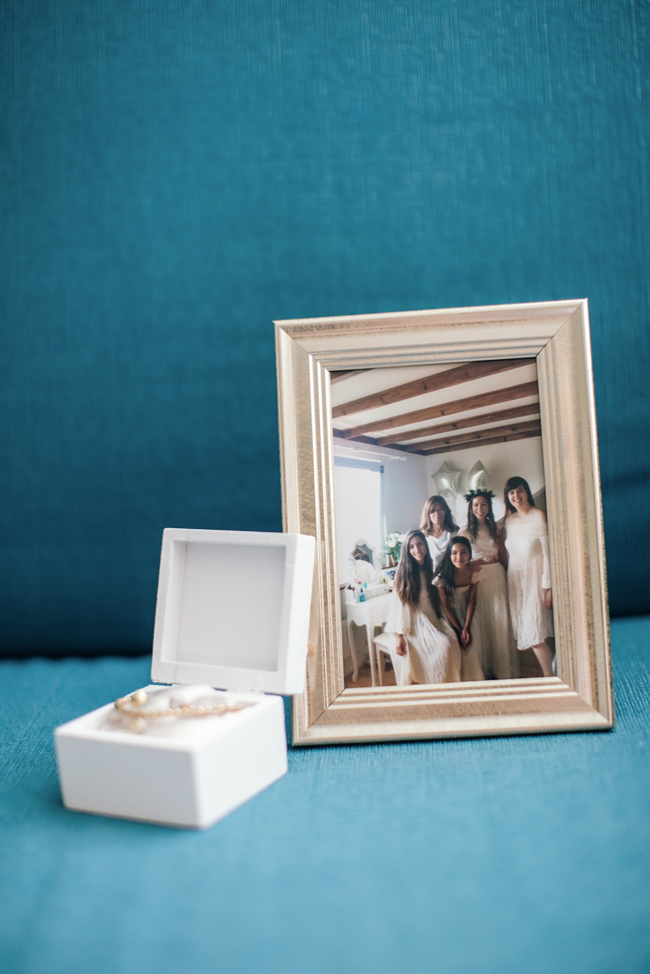 Bridesmaids' favors and a photo frame with image of the bride and her bridesmaids earlier that year when shopping for wedding dresses together.