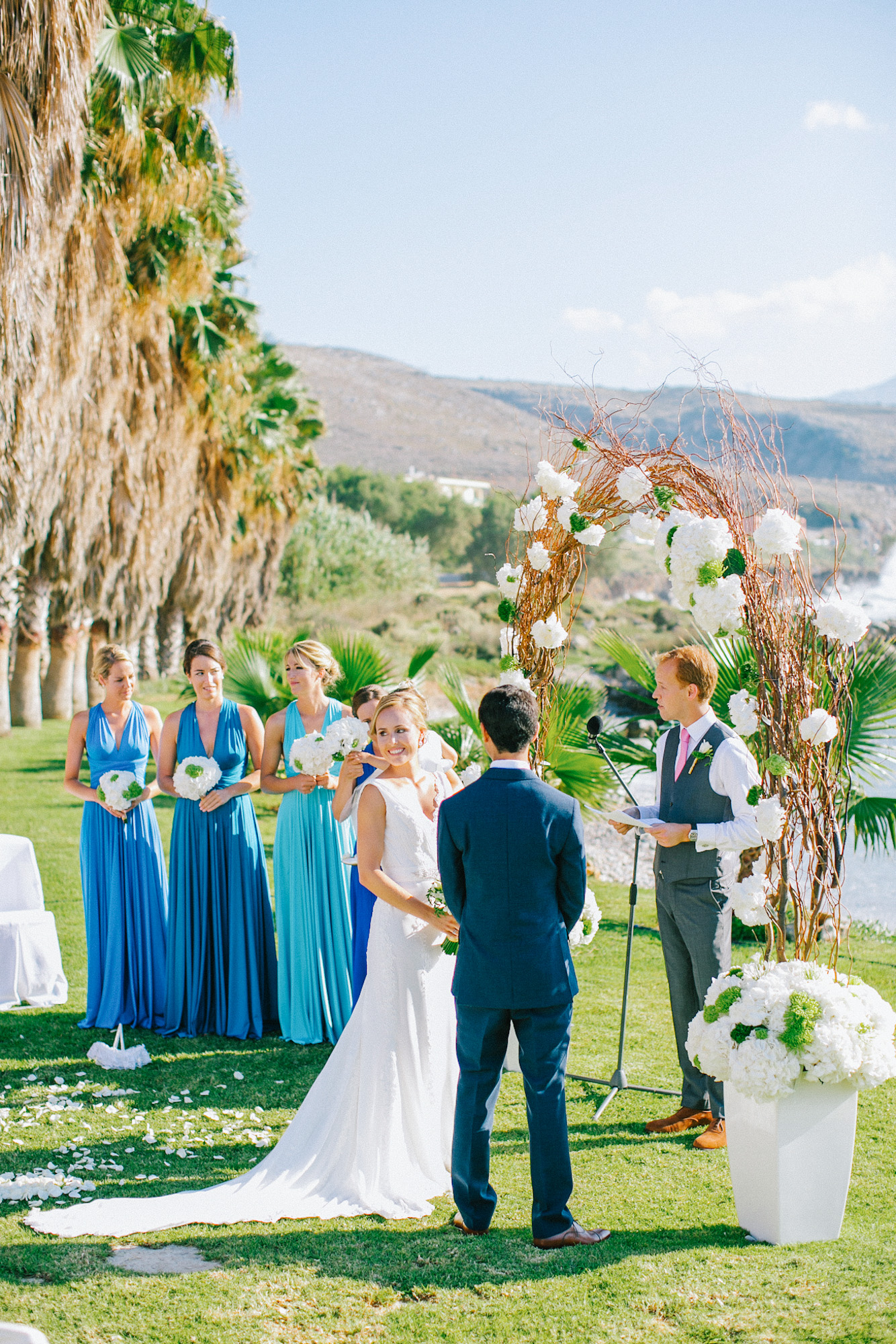 Portrait of a bride and groom during their afternoon wedding ceremony in palm tree wedding estate in Rethymno Crete photographer by a professional destination wedding photographer.