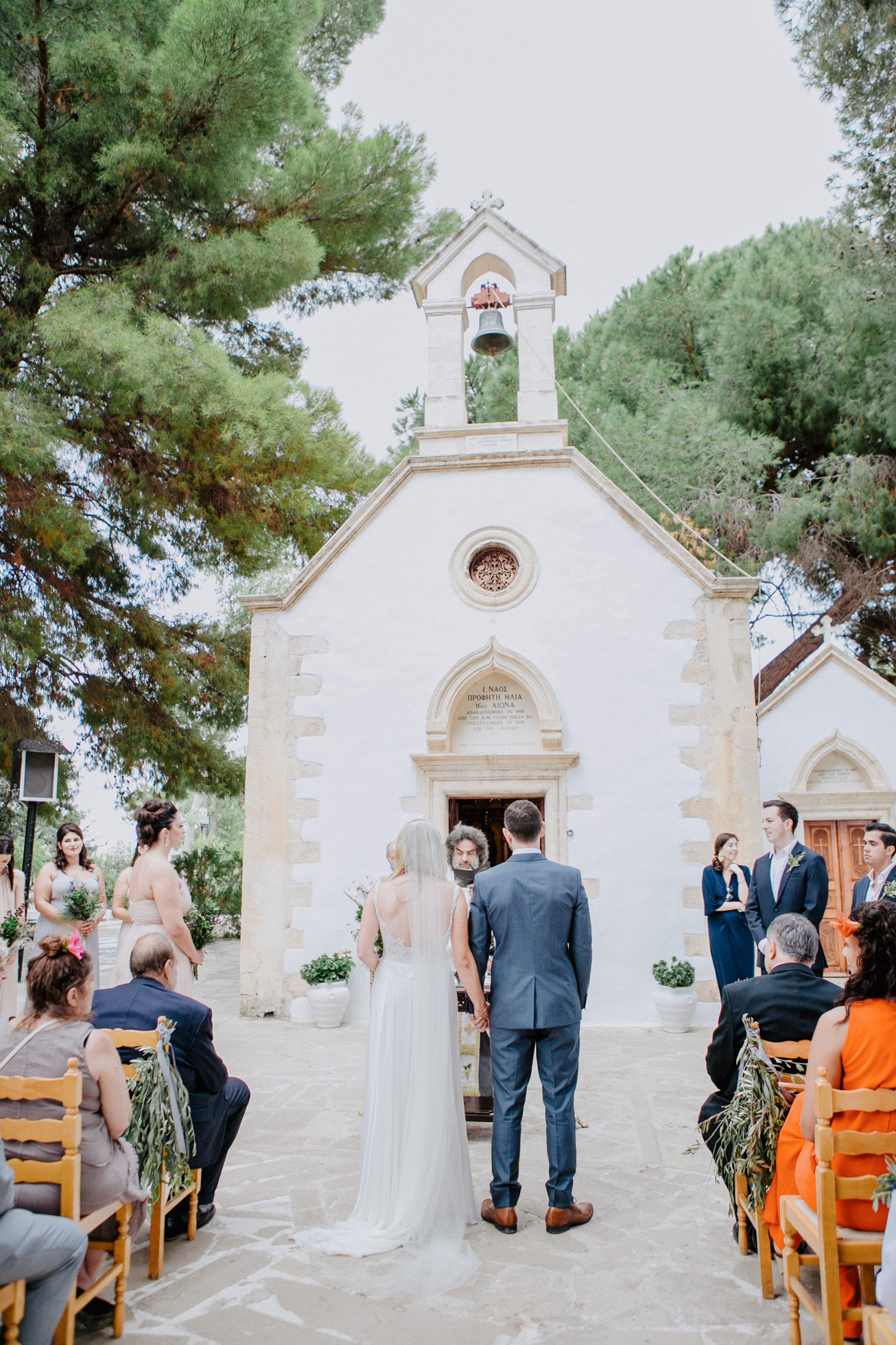 Elegant couple on their Greek orthodox destination wedding ceremony in Profitis Ilias, Chania & Crete.