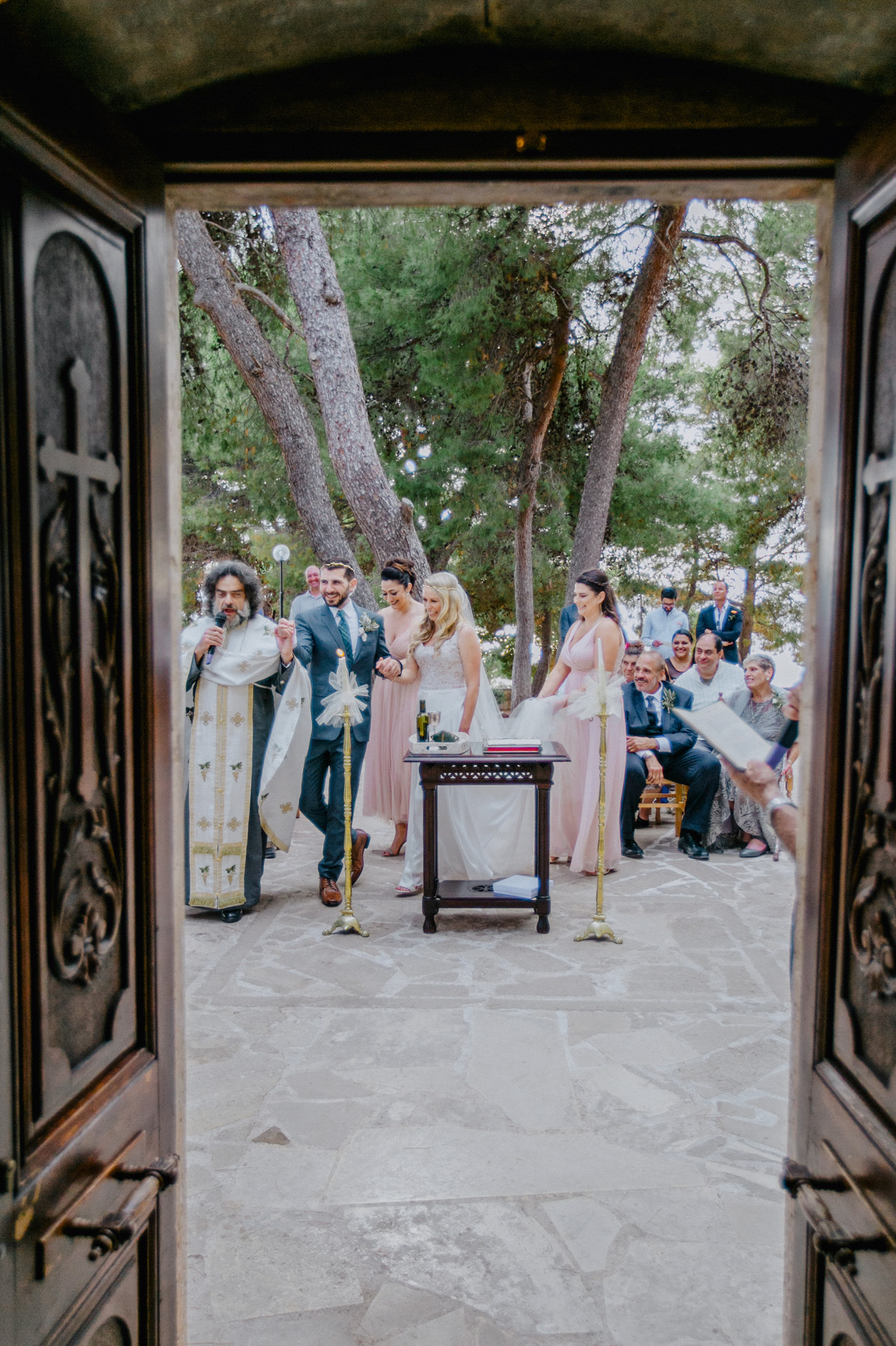 Elegant couple on their Greek orthodox destination wedding ceremony in Profitis Ilias, Chania Crete.