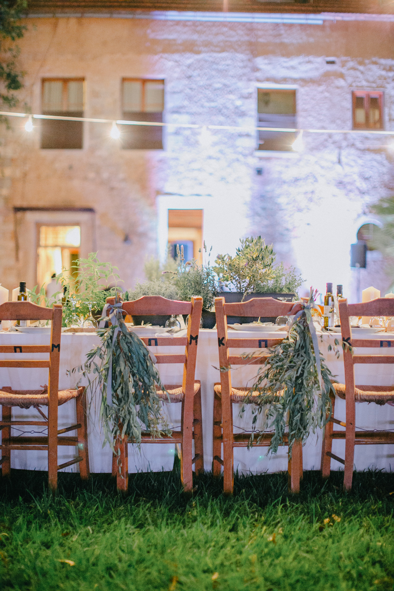 Rich wedding reception dinner setup for an exclusive wedding event in Metohi Kindelis, Chania, Crete photographed by professional photographer team.