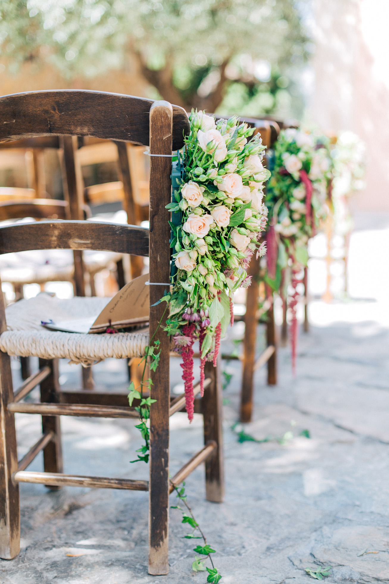 Ceremony venue with decorations and florals ready for a destination wedding in Grecotel Agreco Farm in Crete, Greece, documented by professional wedding photographer.