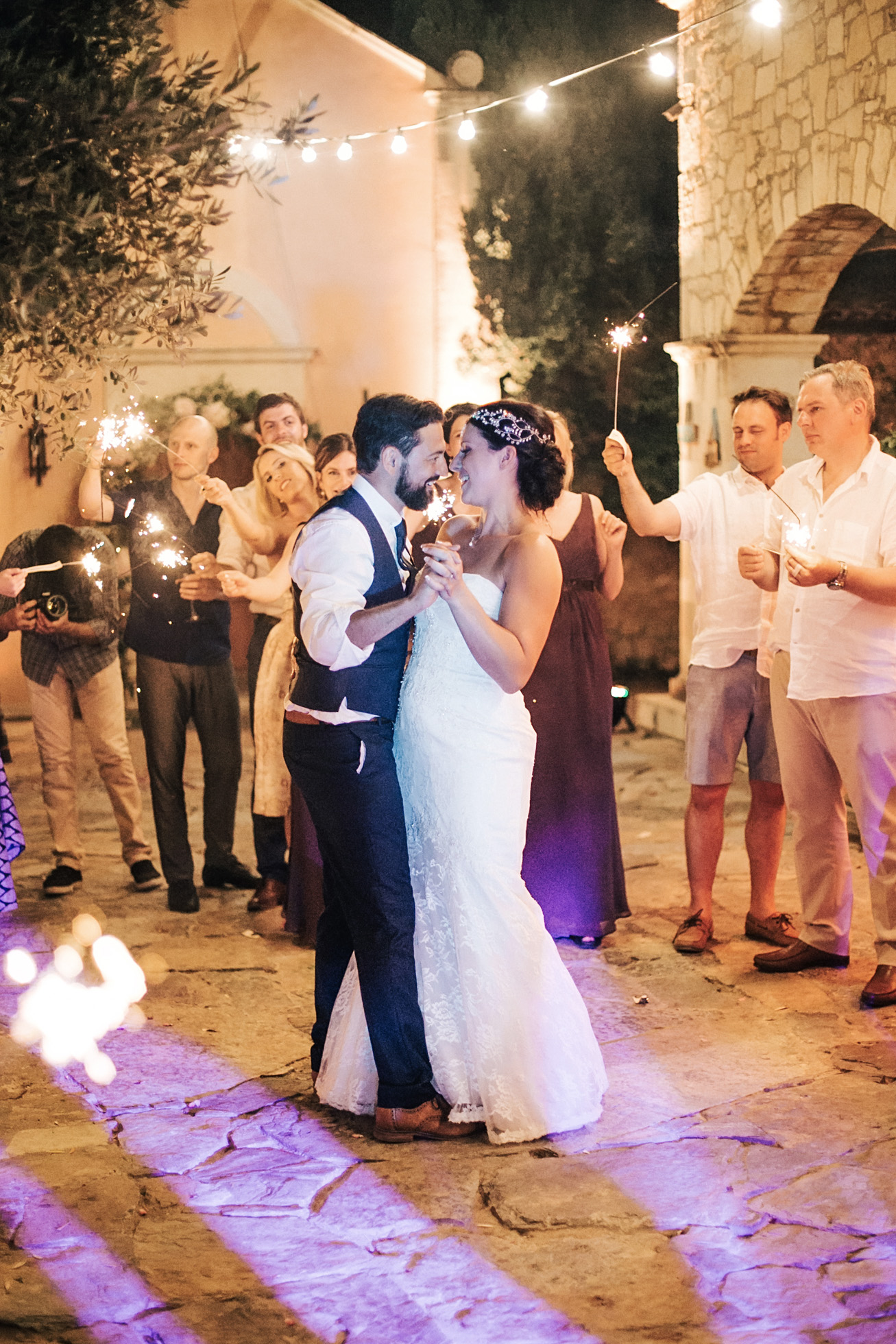 Candid evening images of bride and groom at their sparkler lit wedding reception in Agreco Farm, Crete, Greece.
