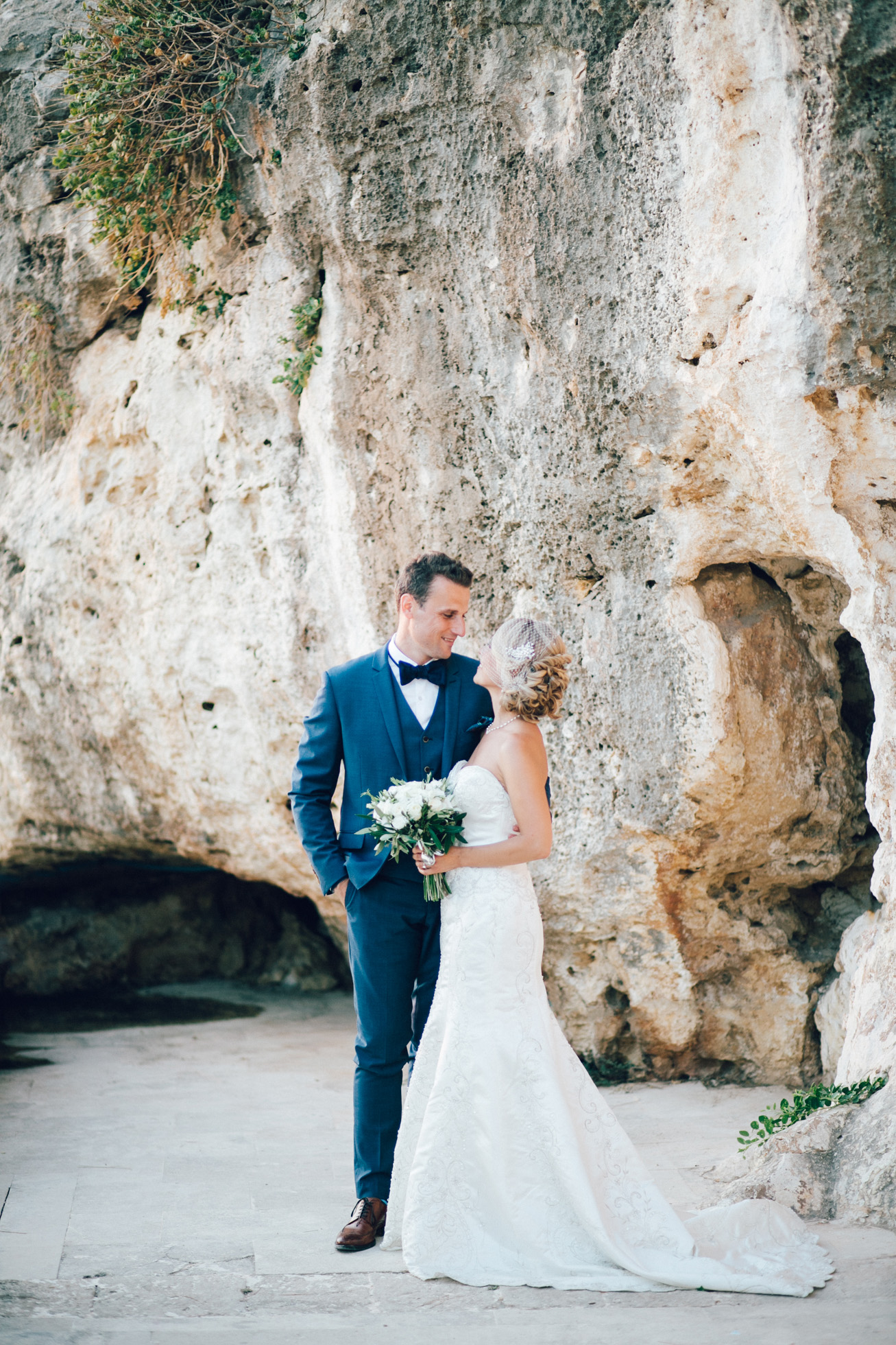 Just married! Elegant bride and groom posing for portraits on their destination wedding day in Crete island, Greece.