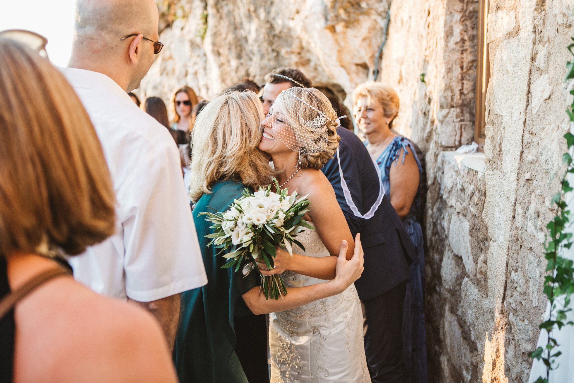 Beautiful elegant couple during their greek orthodox destination wedding ceremony in Crete, Greece.
