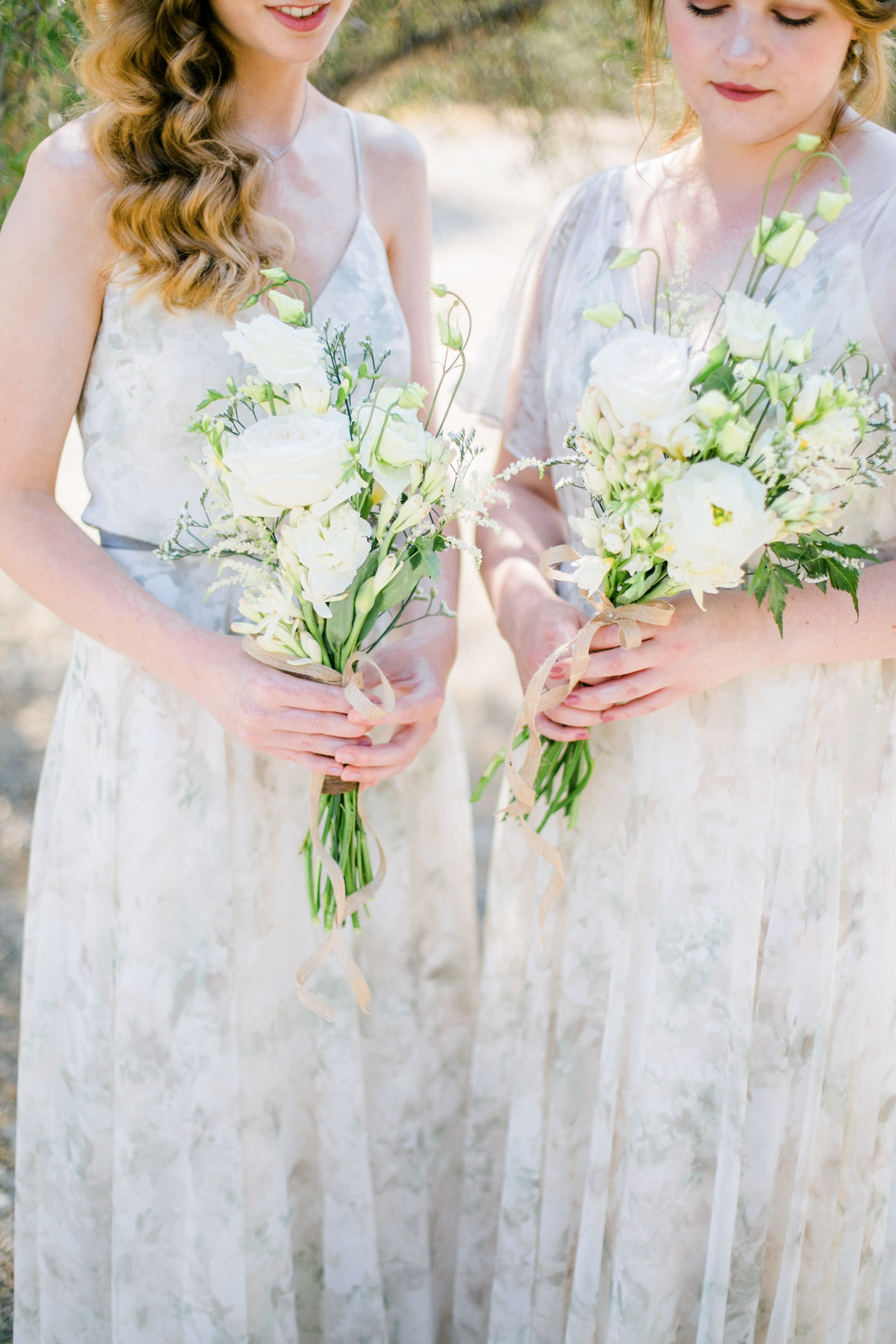 Bridesmaids holding flower bouquets on a wedding day.